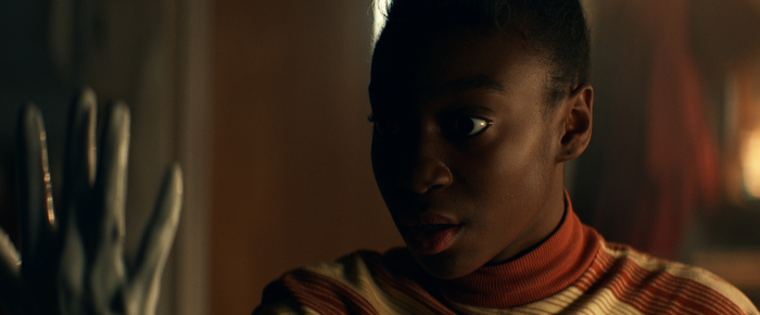 Shahadi Wright Joseph's hand covered in white paint in Them